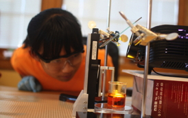 "A middle-school student at the Next Generation School in Champaign, Ill., creates a 3-D object with a classroom 3-D printer. Students in grades K-12 can ""print"" 3-D objects from computer-generated sources right in the classroom using a rapid prototyping or 3-D lithography process. The process is based on a research project that was headed by Nicholas Fang, an assistant professor in the Mechanical Engineering Lab at the University of Illinois at Urbana-Champaign and developed at the Center for Nanoscale Chemical-Electrical-Mechanical Manufacturing Systems (NanoCEMMS) at the university. NanoCemms is a National Science Foundation Nanoscale Science and Engineering Center. 
