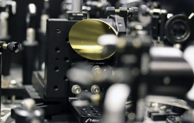 A THz spectrometer driven by femtosecond laser pulses was used to demonstrate THz emission from a split-ring resonator metamaterial