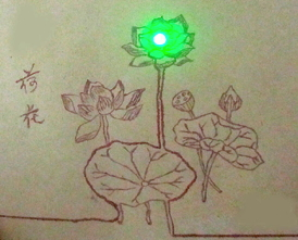 A picture drawn with conductive ink lights up a green LED.