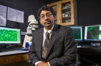 Ravi Bellamkonda, lead investigator for the GBM project and chair of the Wallace H. Coulter Department of Biomedical Engineering at Georgia Tech and Emory University, is shown with equipment used to study the cancer.