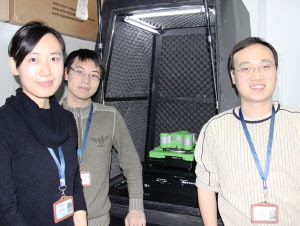 Professor Yi Cao, right, and two of his students with the JPK ForceRobot� system in the Institute of Biophysics at Nanjing University.