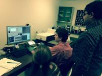 Assistant professor Chanda works with students in his lab at the UCF NanoScience Technology Center.