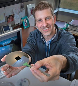 Brookhaven physicist Charles T. Black with one of his nanostructured surfaces