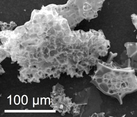 Particles of nitrogen-containing porous carbon are able to capture carbon dioxide from natural gas under pressure at a wellhead by polymerizing it, according to researchers at Rice University. When the pressure is released, the carbon dioxide returns to gaseous form.Credit: Tour Group/Rice University
