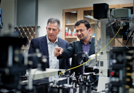 Physics Professor Ali Koymen, left, and Samarendra Mohanty, an assistant professor of physics, discuss their research.