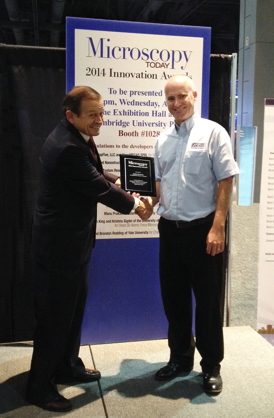 Rob Cain, Asylum Research US Technical Sales Manager (right) receives the award from Charles Lyman, Editor-in-Chief, Microscopy Today.