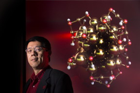 Xiao Cheng Zeng, chemistry professor at the University of Nebraska-Lincoln, is shown with a model of a gold nano-cluster.