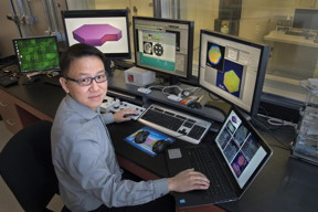 Dong Su in the control room of the aberration-corrected scanning transmission electron microscope (Hitachi HD2700C) at the Center for Functional Nanomaterials, a US Department of Energy Office of Science User Facility at Brookhaven Lab. On the computer screens are images of the platinum-based nanoplates that Su and his collaborators developed. The nanoplates have a thick, ordered shell of platinum that surrounds a platinum and lead alloyed core. This special structure is thought to be behind the high catalytic activity and stability of the nanoplates.