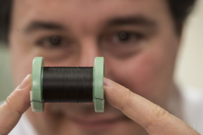 Rice University chemist Matteo Pasquali shows a spool of fiber made of carbon nanotubes. Rice has joined the Department of Energy's Next Generation Machines: Enabling Technologies initiative and will work to increase the conductivity of the fiber for use in electric motors. (Credit: Jeff Fitlow/Rice University)