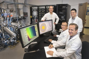 Brookhaven Lab scientists (from left) Ivan Bozovic, Xi He, Jie Wu, and Anthony Bollinger with the atomic layer-by-layer molecular beam epitaxy system used to synthesize the superconducting cuprate samples.
