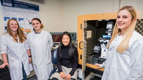Professor Huabing Yin (seated) and her students with their JPK NanoWizard® AFM with the CellHesion® module at the University of Glasgow.
