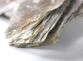 Mica the mineral flakes off in fine sheets.