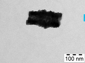 icture of a hybrid particle taken by a transmission electron microscope. Pictured are the inorganic (dark) and organic (light) lamellas that the particle is made of, as well as the tubular shapes (the low-contrast area in the middle). Through vaporisation with Europium, the hybrid stage can be transformed into pure EuO. 