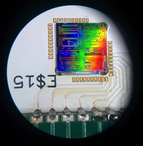 Microscope image of a silicon chip that contains tens of quantum optics experiments. The newly developed detector is tiny: it occupies less than 1mm2 on the hip shown, in the bottom right.