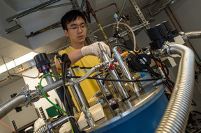 Researchers at Rice University, including graduate student Xinwei Li, have observed and measured a Bloch-Siegert shift in strongly coupled light and matter in a vacuum. The project could aid in the development of quantum computers. (Credit: Jeff Fitlow/Rice University)
