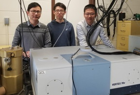 Left to right: Research contributors and Lehigh electrical and computer engineering graduate students Ji Chen, Liang Gao and Yuan Jin stand in the Terahertz Photonics laboratory of Sushil Kumar in the Sinclair Building at Lehigh University.