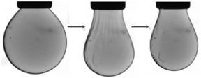 "Nanocrystals within a liquid droplet that is injected into an oily solution (left) are chemically compressed into a solid-like ""jammed"" 2D state (middle) -- which causes wrinkles to form on the surface of the droplet -- and then revert to a relaxed, liquid-like state (right) in which the wrinkles smooth out.