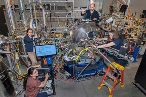 Professor Roopali Kukreja from the University of California in Davis and the CSX team Wen Hu, Claudio Mazzoli, and Andi Barbour prepare the beamline for the next set of experiments.