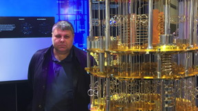Photo shows Dr. Alexeev with a model of an IBM Q quantum computer.