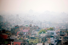 Caption: Air pollution from coal-fired plant has been a major concern for air quality in such cities as Delhi, India, photographed here by Getty Images.