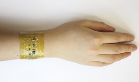 "A person wears an ""electronic skin"" device on the wrist.