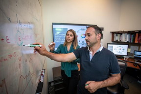 Berkeley Lab scientists Tijana Radivojevic (left) and Hector Garcia Martin working on mechanistic and statistical modeling, data visualizations, and metabolic maps at the Agile BioFoundry last year.