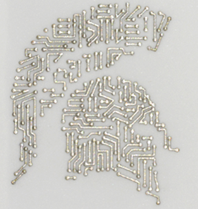 MSU researchers developed a process to create more resilient circuitry, which they demonstrated by creating a silver Spartan helmet. The circuit was designed by Jane Manfredi, an assistant professor in the College of Veterinary Medicine. Credit: Acta Materialia Inc./Elsevier